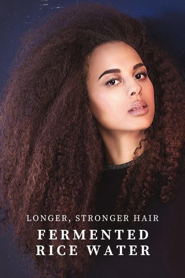 Model with Long Kinky Hair and the words Longer, Stronger Hair Fermented Rice Water