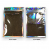 Comparison photo of one 50 gram and one 25 gram pack of Chebe Powder Herbal Super Gro Mix