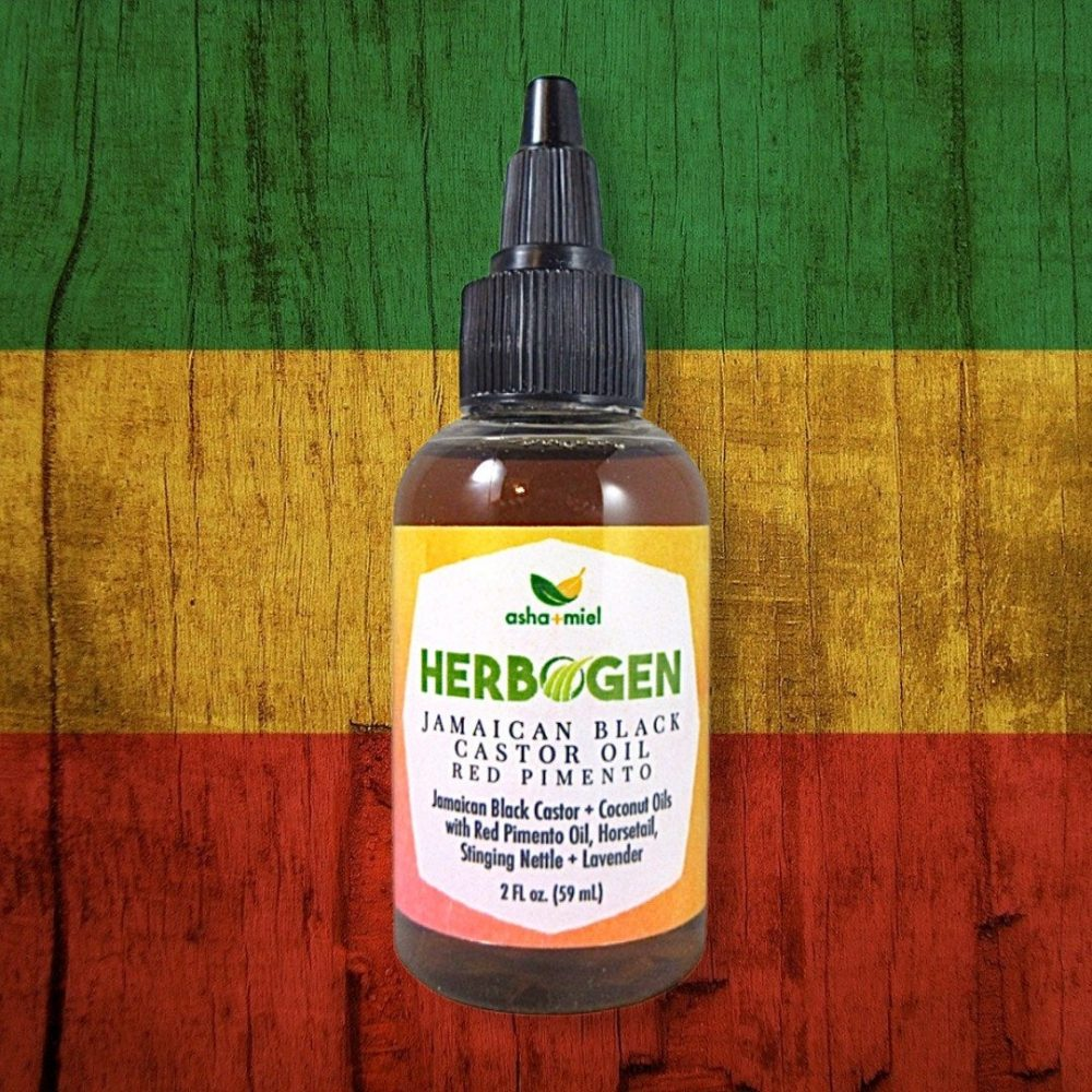 Red Pimento Hair Growth Oil, Jamaican Black Castor Oil, Stinging Nettle Hair Oil, 2 ounce bottle on decorative green, yellow and red background