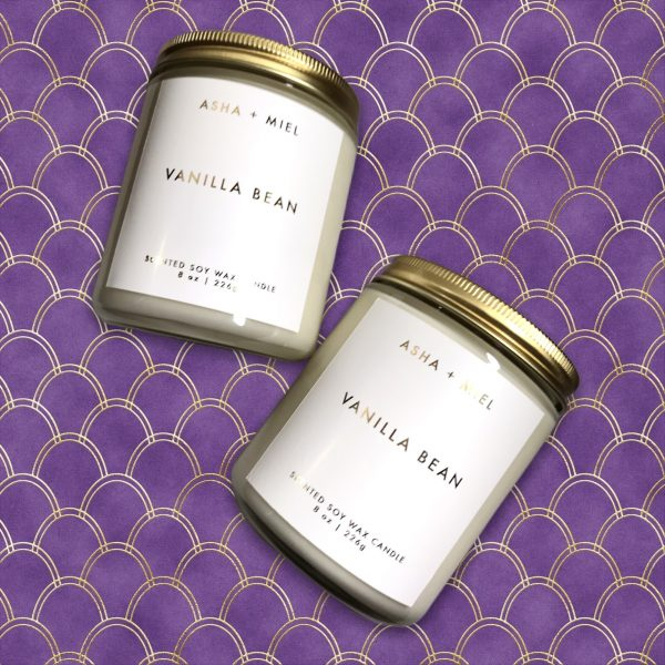 two 8 ounce jars of vanilla bean soy candles